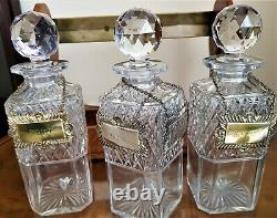 ANTIQUE TANTALUS WITH 3 GLASS DECANTERS by Betjemann