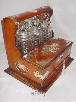 ANTIQUE VICTORIAN EDWARDIAN OAK BRASS MOUNTS GAMING TANTALUS CUT GLASS DECANTERS