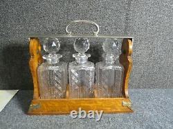 Antique Oak Cut glass bottles Tantalus Betjemann's Patent London