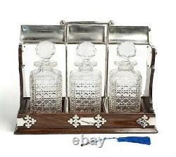 Antique Tantalus with 3 Cut Glass Decanters In Oak & Silver Plate Locking Frame