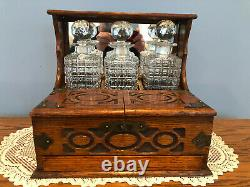 Antique Victorian Oak Tantalus with Spring Loaded Drawer & Cut Glass Decanters