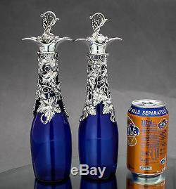 Antique cobalt Bristol blue glass 2 wine decanters silver plate grapevine top