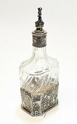 Dutch Silver & Cut Glass Wine Decanter, circa 1900. Figural Scenes
