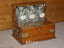 Edwardian Oak Triple Tantalus With Secret Games Drawer & Three Cut Glass Decanters