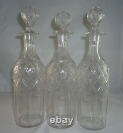 English Silver Tantalus Set with 3 Cut Crystal Decanters
