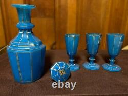 Translucent 4 piece set with decanter & 3 cups of gilded cut blue opaline glass